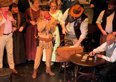 Lisa Lilwall as Calamity (centre), Bob Taylor as Doc (seated)