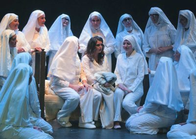 Emma Sansom, Laura Woodall, Lucy Traves (seated, l to r) and nuns
