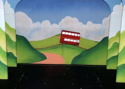 The bus drives over the hills - and gets a huge cheer from the audience!